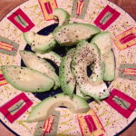 Avocado with lemon juice and cracked pepper