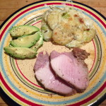 roas pork with potatoe leek gratin and sliced avocado
