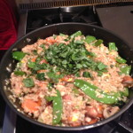 fried rice topped with fresh basil