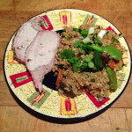 Fried rice topped with fresh scallions and roast pork dinner